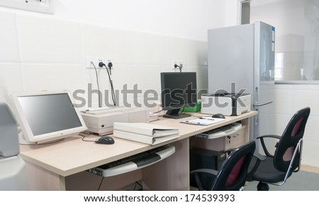 Wooden office desk with computer and printer.