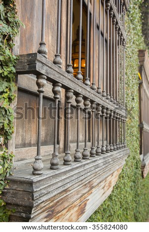 Wooden old carved window details, colonial architecture in Cali. Colombia - stock photo