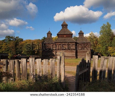Wooden old house and with a gate. Summer in Kiev museum Pirohovo. - stock photo