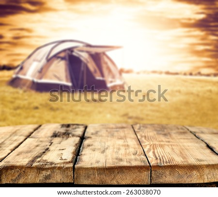 wooden old table and tent decoration  - stock photo