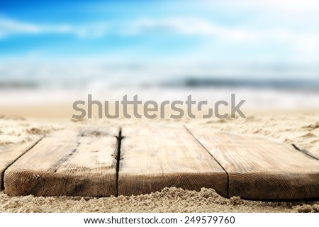 wooden old table top and sea space  - stock photo