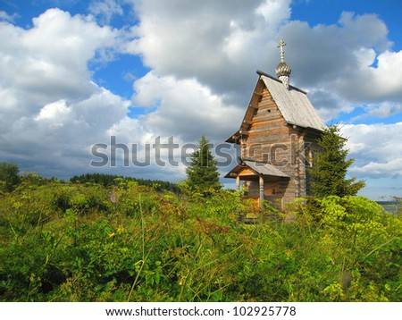 wooden orthodox church in green grass