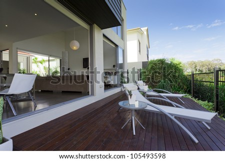 wooden outdoor deck in modern Australian mansion - stock photo