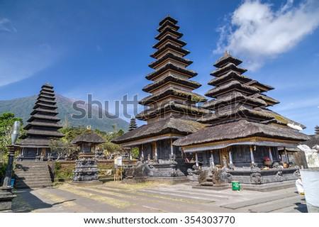Wooden pagoda roofs of Pura Besakih Balinese temple - stock photo