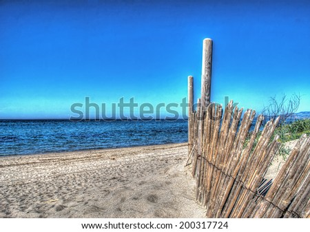 wooden palisade by the sea - stock photo