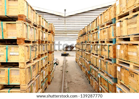 Wooden pallet bunch in warehouse before shipment - stock photo