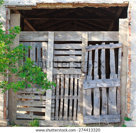 wooden pallets hide the entrance to the old barn