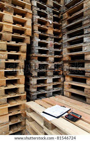 Wooden pallets in a factory yard - stock photo
