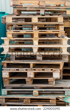 Wooden pallets near a wall - stock photo