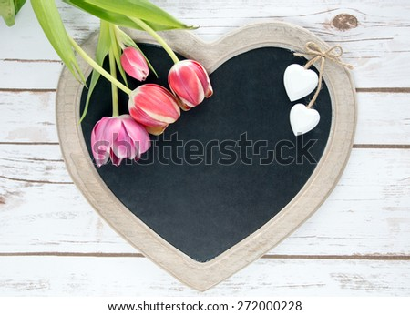 Wooden panel in heart shape with tulips / Wooden Panel - stock photo