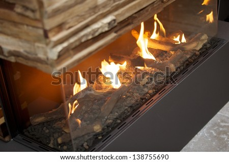 Wooden panels with a luxury and contemporary indoor fireplace - stock photo
