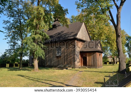 Wooden parish church of St. Nicholas in Tum near Leczyca, Poland - stock photo