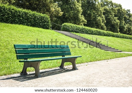 wooden park bench at a park - stock photo