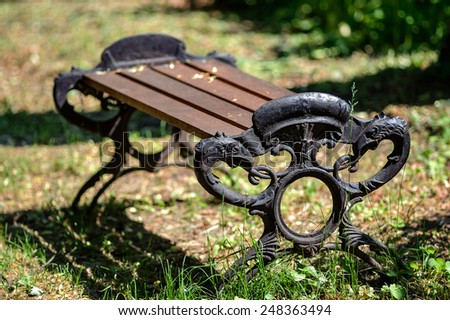 Wooden park bench in nature. Summer time - stock photo