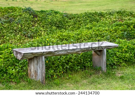 Wooden park bench in the garden - stock photo