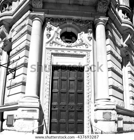 wooden parliament in london old   door and marble antique  wall