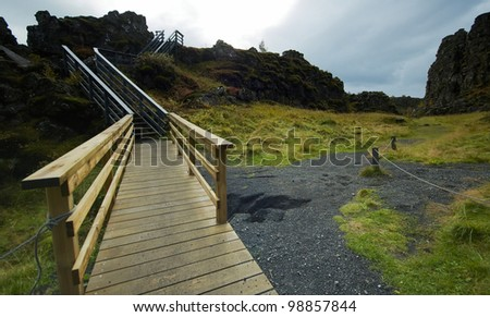 Wooden passage at Icenland's Thingvallir National park - stock photo