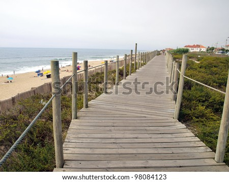 wooden path above the beach, and a fragment of the Atlantic Ocean, Portugal
