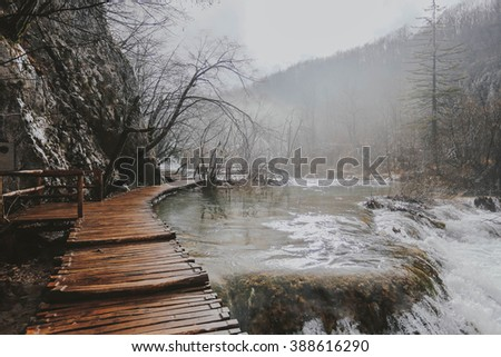 Wooden path in the Plitvice Lakes National Park in Croatia in winter - stock photo