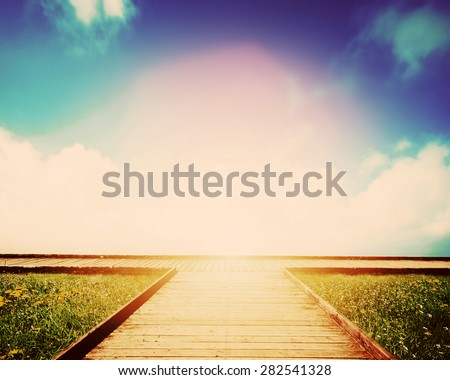 Wooden path leading to crossroads. Direction, way to choose. Concept of decision making, future, environment etc. - stock photo