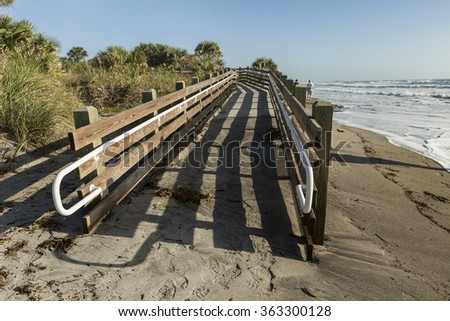 Wooden path leading to the sea. Ocean access boardwalk to Venice Beach, horizontal format. Florida - stock photo