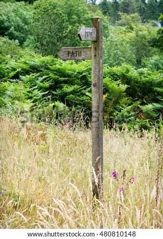 Wooden path sign or signpost in nature
