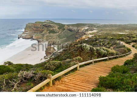 Wooden path with beautiful sea view. Cliffs and ocean at Cape of Good Hope, South Africa - stock photo