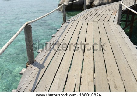 Wooden pathwat to beautiful tropical island.