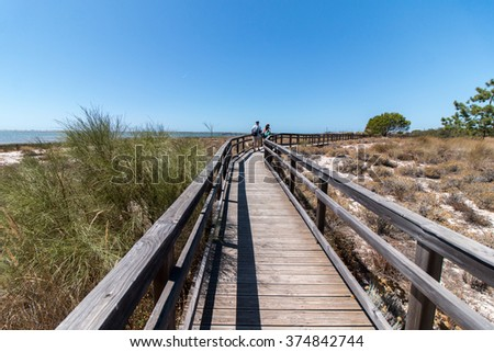 Wooden pathway on the Ria Formosa marshlands located in the Algarve, Portugal.
