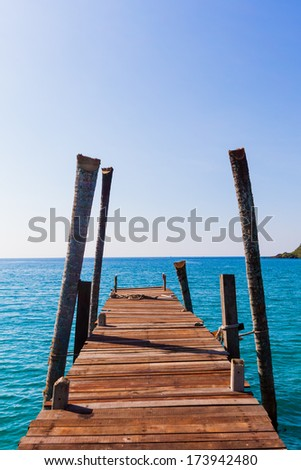 Wooden pathway. Tropical Resort. boardwalk on beach - stock photo