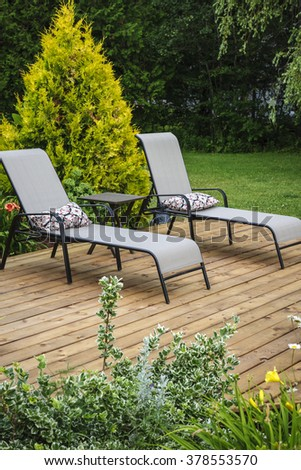 Awesome Wooden Patio Or Deck In Backyard Of A Home With Outdoor Furniture