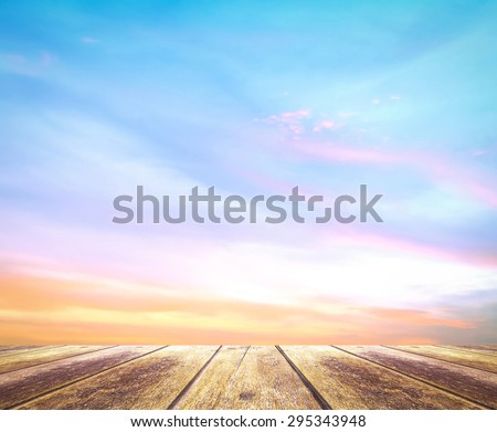 Wooden paving and abstract soft and beautiful sky textured background: yellow pink and blue patterns. - stock photo