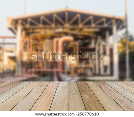 Wooden paving and blurred Chemical plant  - stock photo