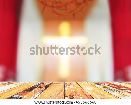 Wooden paving and blurred crown of thorn and the cross in the church background, Mercy Evangelical concept, Praise God concept, Defocus in church. - stock photo
