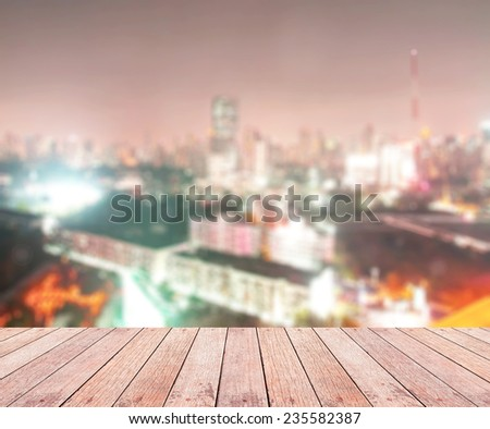 Wooden paving and blurred night over city background with circle light. blur backgrounds concept.