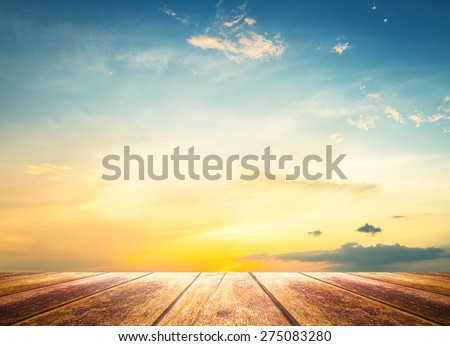 Wooden paving with beautiful sunset background. Color Cloud Sun Table Floor Air Plain Sunrise Ecology World Environment Day Earth Hour concept. - stock photo