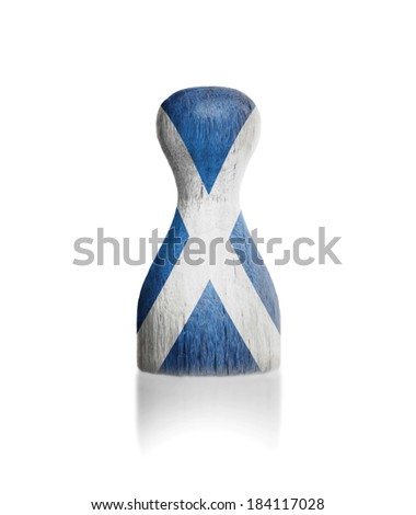 Wooden pawn with a painting of a flag, Scotland - stock photo