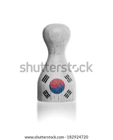Wooden pawn with a painting of a flag, South Korea - stock photo