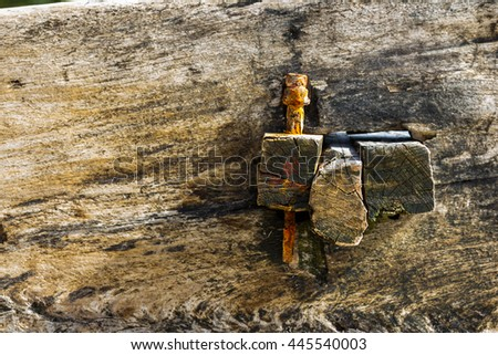 wooden peg detail showing rough handmade craftsmanship of a dhow outrigger.