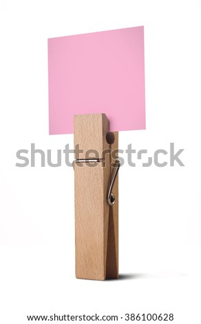 wooden peg holding a white note isolated on white background - stock photo