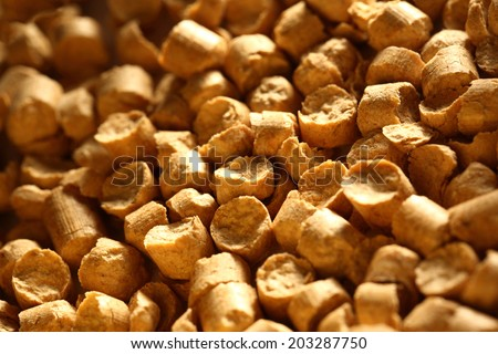 Wooden pellets as background - stock photo