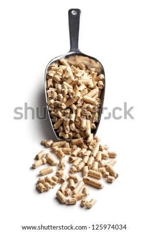 Wooden pellets -bio fuel on scoop. - stock photo