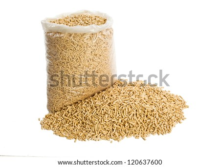 wooden pellets in plastic bag on white background - stock photo