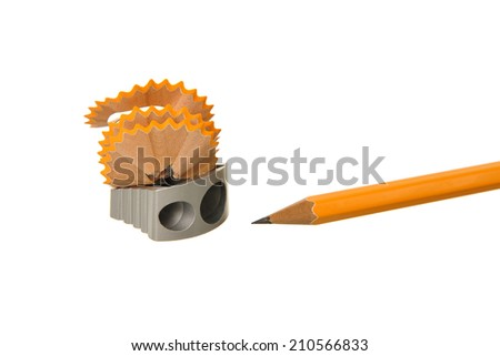 Wooden pencil shavings with pencil on white paper background