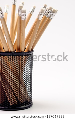 Wooden pencils in a black metal cup - stock photo