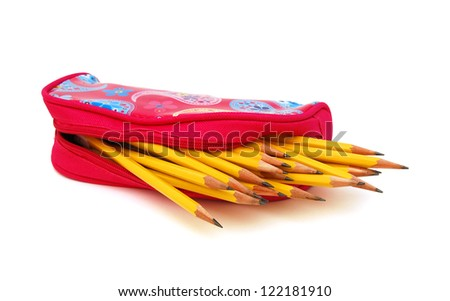 Wooden pencils in pink small bag isolated on white - stock photo