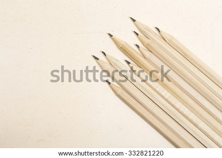 Wooden pencils on a paper background - stock photo