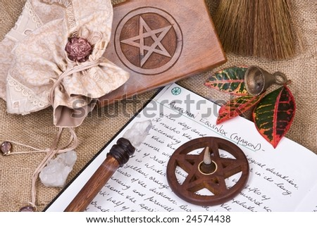 wooden pentacle with incense burning - with hand written book of shadows and fall leaves - autumn equinox mabon ritual