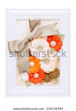 wooden photo frame with handmade paper flower - stock photo