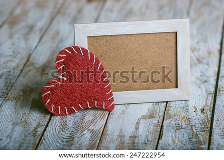 wooden photo frame with Valentine's symbol